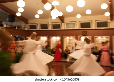 Istanbul, Turkey - July 4 2013 : Sufism devotees performing the whirling dervish ritual at a Sufi ceremony in Istanbul