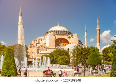 ISTANBUL, TURKEY - JULY 5, 2014: Hagia Sophia (Holy Wisdom) Ottoman imperial mosque and now a museum (Ayasofya Müzesi) in Istanbul, Turkey. Blue sky with clouds in background.
