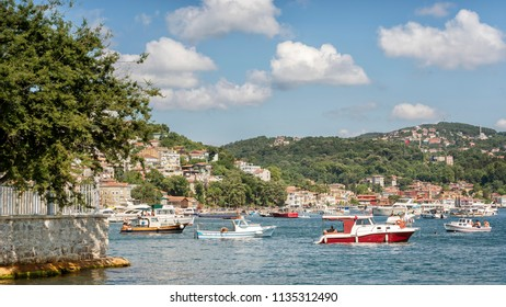 ISTANBUL, TURKEY, JULY 7, 2018: Small boats anchored near Beykoz coastline, Beykoz is a district in Istanbul, Turkey at the northern end of the Bosphorus on the Anatolian side.