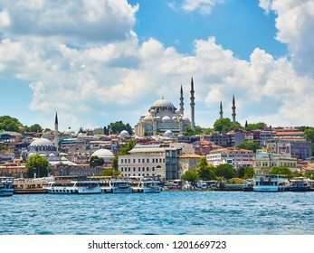 Istanbul, Turkey - July 8, 2018. Eminonu district skyline with the Suleymaniye Camii mosque in the background and the Eminonu Ferryboat docks facing the mouth of the Golden Horn Bay. Istanbul, Turkey.