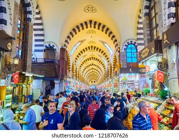 Istanbul, Turkey - July 9, 2018. Tourists in Misir Carsisi, the spice bazaar of Eminonu district, Istanbul, Turkey.