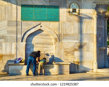 Istanbul, Turkey - July 9, 2018. Citizens refreshing in The Mihrimah Sultan Fountain. Uskudar district, Istanbul, Turkey.