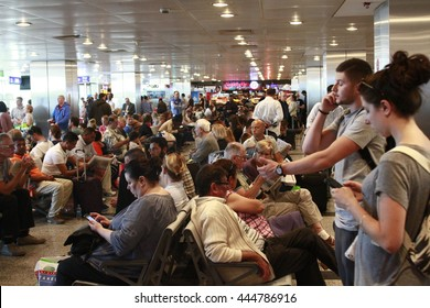 ISTANBUL, TURKEY - June 01, 2015: Tourists are waiting in a crowded space near the gates for the delayed flight in Turkey's largest airport, Istanbul Ataturk, Turkey.