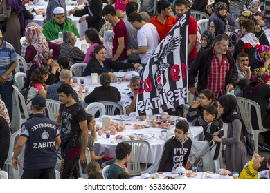 ISTANBUL, TURKEY - JUNE 03, 2017: Rows of tables set up for Ramadan and people waiting the Iftar food near the Zeytinburnu, Istanbul, Turkey.