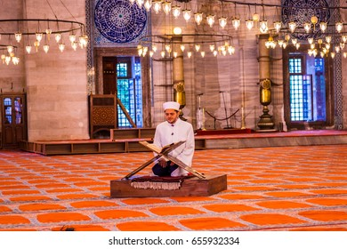 ISTANBUL, TURKEY JUNE 05, 2017:The imam prays and reads the Quran during ramadan month in Suleymaniye mosque,Istanbul,Turkey. Tourists and local people visit this historical landmark every season