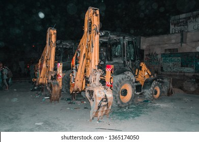 Istanbul, Turkey - June 06, 2013: Two destroyed excavators with broken windows and burst tire during the Gezi Park protests.