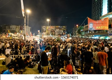 Istanbul, Turkey - June 06, 2013: Civilians near the Ataturk Culture Center (AKM) building during the Gezi Park protests at night.