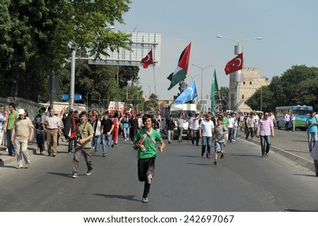 ISTANBUL, TURKEY -JUNE 07: Unidentified activists participate in a protest organized by Humanitarian Relief Foundation to commemorate Mavi Marmara raid on June 07,2010 in Istanbul,Turkey.