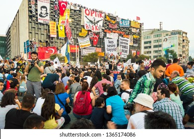 Istanbul, Turkey - June 08, 2013: Civilians near the Ataturk Culture Center (AKM) building during the Gezi Park protests.