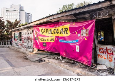 Istanbul, Turkey - June 08, 2013: Ruined building exterior during the Gezi Park protests. Text on the banner: Capulcu Wedding Area
