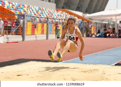 ISTANBUL, TURKEY - JUNE 09, 2018: Undefined athlete triple jumping during Balkan U18 Athletics Championships