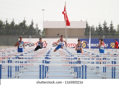 ISTANBUL, TURKEY - JUNE 09, 2018: Athletes running 110 metres hurdles during Balkan U18 Athletics Championships