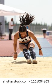 ISTANBUL, TURKEY - JUNE 09, 2018: Undefined athlete triple jumping during Balkan U18 Athletics Championships