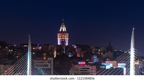 ISTANBUL, TURKEY - JUNE 10, 2018: Illuminated Galata Tower in Istanbul, Turkey with dark blue sky at the background.