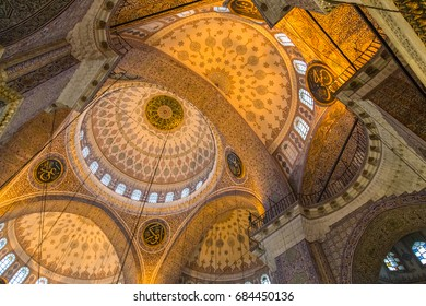 ISTANBUL, TURKEY - JUNE 11, 2014: Interior of Yeni Mosque (New Mosque) in Istanbul, Turkey. Yeni Mosque is an Ottoman imperial mosque located in Fatih district.