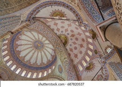 ISTANBUL, TURKEY - JUNE 11, 2014: Interior of the Blue Mosque (Sultan Ahmed mosque), an Ottoman imperial mosque in Istanbul, Turkey. Abstract shot of main dome and arches with stained glass windows.