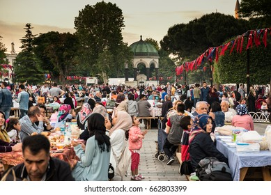 ISTANBUL, TURKEY - JUNE 11, 2017: Muslim people who are fasting wait for the adhan (ezan) and evening meal (Iftar) in Ramadan month in Sultan Ahmet Park, Istanbul, Turkey