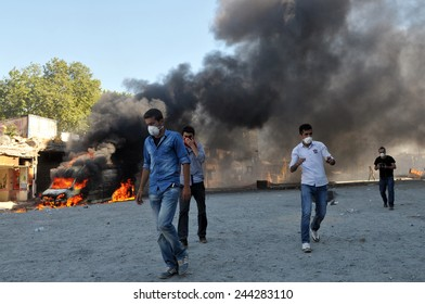 ISTANBUL, TURKEY - JUNE 11: Protesters against the cutting of trees in Gezi Park clash with police. Police use tear gas and water cannon against the protesters June 11, 2013 in Istanbul, Turkey.
