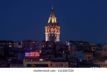 ISTANBUL, TURKEY - JUNE 13, 2018: Illuminated Galata Tower in Istanbul, Turkey with dark blue sky at the background.