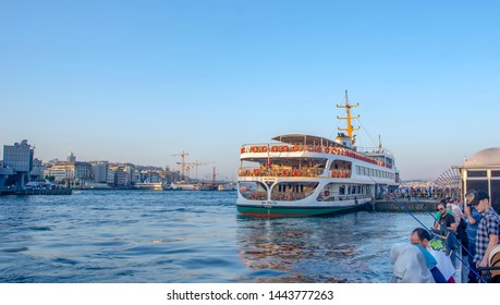 Istanbul, Turkey June 13, 2019: Muslim architecture and water transport in Turkey - Beautiful View touristic landmarks from sea voyage on Bosphorus. Cityscape of Istanbul at sunset - old mosque and tu