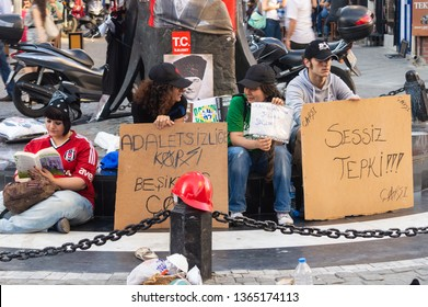 Istanbul, Turkey - June 19, 2013: Man making silent protest during Gezi Park protest. Silent protest has been taken up by hundreds of anti-government demonstrators and spread to several Turkish cities