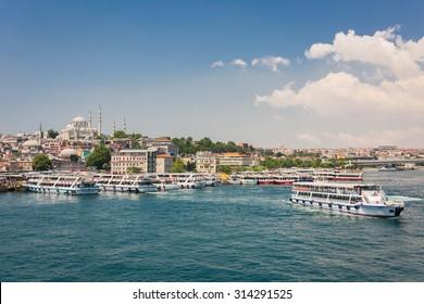 ISTANBUL, TURKEY - JUNE 20: Tourist ship near Galata Bridge on June 20, 2015 in Istanbul, Turkey