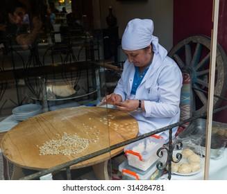 ISTANBUL, TURKEY - JUNE 20: Turkish woman preparing food on June 20, 2015 in Istanbul, Turkey