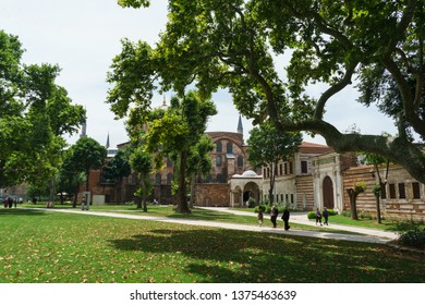 ISTANBUL, TURKEY - JUNE, 2018. Historic city park Gulhane Park in Eminonu district in Istanbul, Turkey; Topkapi Palace on the adjacent territory. Tourists and visitors of the city walk in the museum.