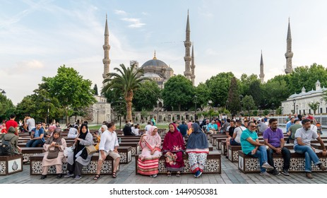 istanbul, Turkey - June 2019: Tourists resting and relaxing infront of Blue Mosque Sultanahmet Camii