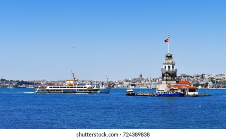 ISTANBUL, TURKEY - JUNE 25, 2017 : Istanbul's iconic ferry passes thought Bosphorus next to Maiden Tower, known as Kiz Kulesi in Turkish.