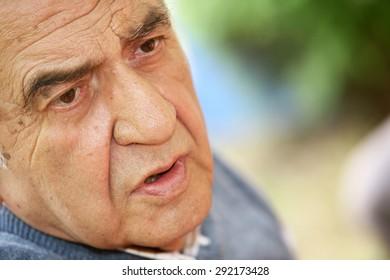 ISTANBUL, TURKEY - JUNE 25: Famous Turkish sociologist, communications scholar and translator Unsal Oskay portrait on June 25, 2009 in Istanbul, Turkey.