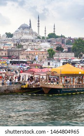 Istanbul, Turkey - June 26, 2016: Istanbul vertical Cityscape, Eminonu former district. People are on the coast of Golden Horn, Suleymaniye Mosque is on a background
