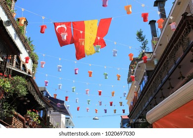 ISTANBUL, TURKEY, JUNE 26TH 2013: Multicoloured flags and street decorations billowing in the wind against blue sky
