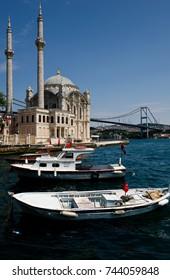 Istanbul, Turkey - June 4, 2015: City life near Ortakoy Mosque in sunny summer day