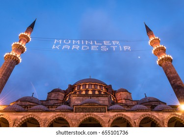 ISTANBUL, TURKEY - JUNE 4, 2017: Mahya of Muslims are brother is written and hung between minarets of Suleymaniye Mosque. Mahya is to write with light especially during ramadan month for muslims.