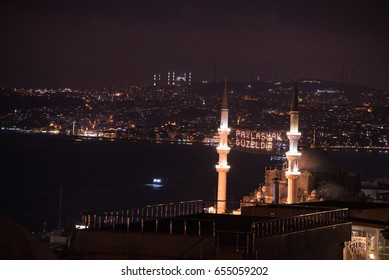 """ISTANBUL, TURKEY - JUNE 4, 2017:Mahya of ?�""""Muslims are brothers""""?� is written and hung between minarets of Suleymaniye Mosque. Mahya is to write with light especially during ramadan month for muslims"""