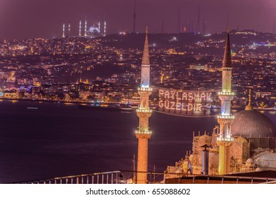 ISTANBUL, TURKEY - JUNE 4, 2017:Mahya of ?�,Muslims are brothers, is written and hung between minarets of Suleymaniye Mosque. Mahya is to write with light especially during ramadan month for muslims