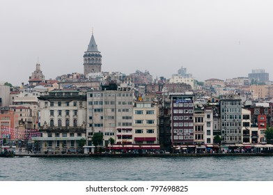Istanbul, Turkey - June 5, 2015: Galata Tower over the Golden Horn in rainy day