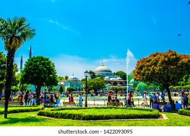 ISTANBUL, TURKEY - JUNE 5, 2019: View of Sultanahmet Mosque from Sultanahmet Park in sunny day. The mosque was built in 1609-1616 by design of Sedefkar Mehmed Agha during the rule of sultan Ahmed I.