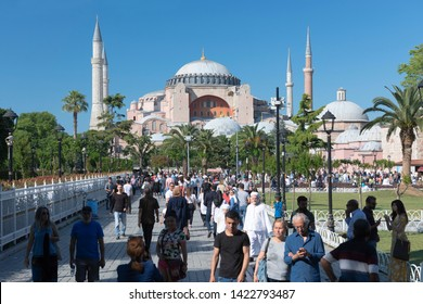 ISTANBUL, TURKEY, JUNE 7, 2019: People walking at Sultanahmet Square, Hagia Sophia can be seen at the background. Sultanahmet District is the heart of old Istanbul