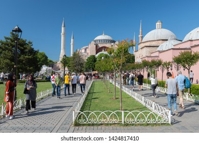 ISTANBUL, TURKEY, JUNE 7, 2019: People walking at Sultanahmet Square, Hagia Sophia can be seen at the background. Sultanahmet District is the heart of old Istanbul.