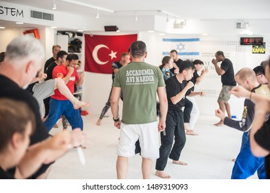 ISTANBUL, TURKEY - Maj 30 - Jun 02. 2019. Kapap instructor Roberto Lerici from Italy, demonstrates escrima stick fighting to large group of students on GENERAL MEETING OF KAPAP INSTRUCTORS
