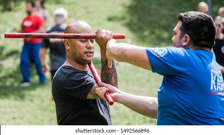 ISTANBUL, TURKEY - Maj 30 - Jun 02. 2019. Group of International martial arts students practice filipino escrima stick fighting on GENERAL MEETING OF KAPAP INSTRUCTORS. Outdoor training