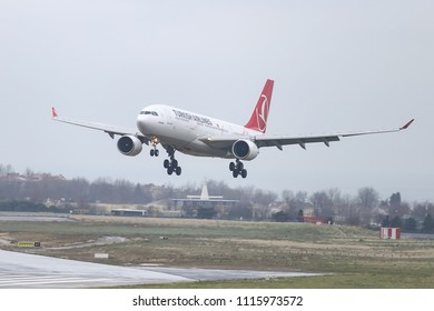 ISTANBUL, TURKEY - MARCH 04, 2018: Turkish Airlines Airbus A330-223 (CN 869) landing to Istanbul Ataturk Airport. THY is the flag carrier of Turkey with 328 fleet size and 302 destinations
