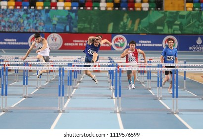 ISTANBUL, TURKEY - MARCH 04, 2018: Athletes running 60 metres hurdles during Turkish Athletics Indoor Competitions
