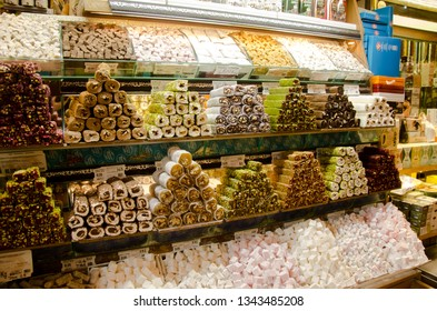 Istanbul, Turkey, March 07, 2019: inside of Egyptian Bazaar or Spice Bazaar is the oldest bazaar in Istanbul. In front of store selling Turkish delight, various locum, colorful sweets