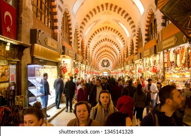 Istanbul, Turkey, March 07, 2019: large group of people inside of Egyptian Bazaar. Spice Bazaar is the oldest bazaar in Istanbul, with details of decorated ceiling and various shops
