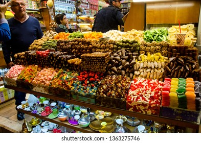Istanbul, Turkey, March 07, 2019: inside of Egyptian Bazaar or Spice Bazaar is the oldest bazaar in Istanbul. In front of store selling various colorful sweets, close up, with some customers inside