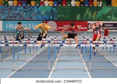 ISTANBUL, TURKEY - MARCH 07, 2020: Athletes running 60 metres hurdles during International U18 Indoor Athletic Match