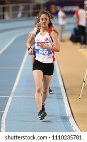 ISTANBUL, TURKEY - MARCH 10, 2018: Undefined athlete race walking during International U18 Indoor Athletic Match